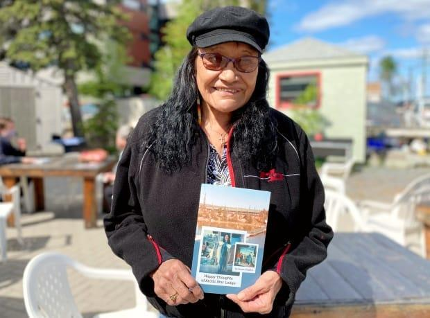 Susan Chaffee published her own book called 'Happy Thoughts of Arctic Star Lodge,' which is based on her time being the 1st female fishing guide in the Northwest Territories. (Chantal Dubuc/CBC - image credit)