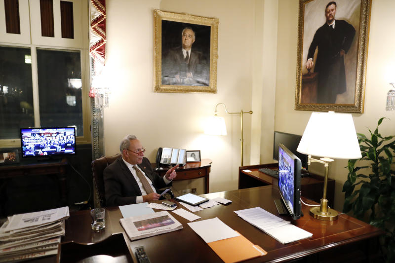 Senate Minority Leader Sen. Chuck Schumer of N.Y., watches from his Senate office as the House votes on the articles of impeachment President Donald Trump, Wednesday, Dec. 18, 2019, on Capitol Hill in Washington. (AP Photo/Andrew Harnik)