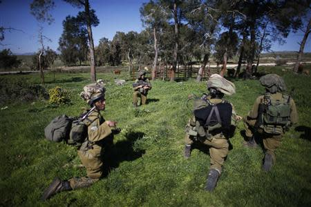 Israeli soldiers take part in an exercise in the Israeli-occupied Golan Heights, near the border with Syria