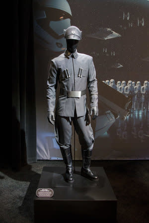 <p>Bookending the pavilion were sections dedicated to the Resistance and First Order. The latter side included a Stormtrooper helmet and blaster, as well as this officer uniform. (Disney Parks/Joshua Sudock) </p>