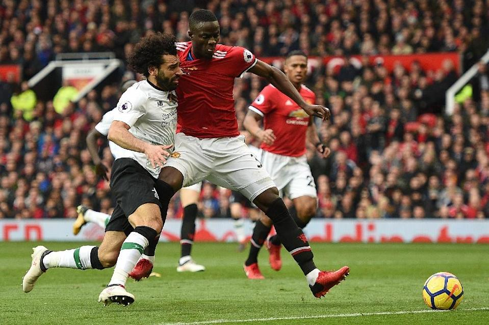 Mohamed Salah (L) vies with Eric Bailly during Liverpool's defeat against Manchester United at Old Trafford (AFP Photo/Oli SCARFF )