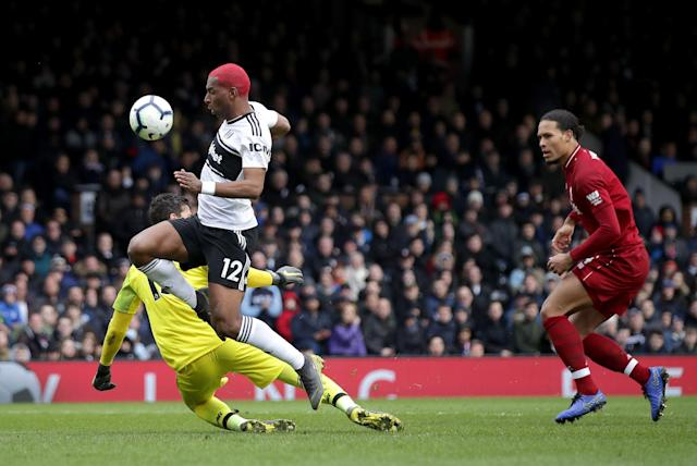 Ryan Babel and Fulham nearly nicked a point thanks to a mistake by Liverpool's Alisson Becker and Virgil van Dijk. (Press Association)