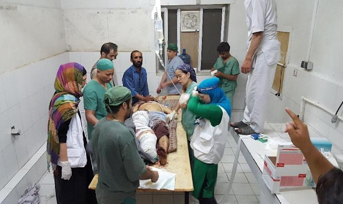 MSF staff treat wounded colleagues and patients in its hospital in Kunduz on October 3, 2015 after the US airstrike (AFP Photo/-)