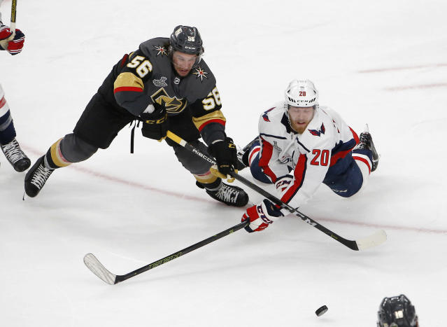 Vegas Golden Knights left wing Erik Haula, left, and Washington Capitals center Lars Eller vie for the puck during the third period in Game 2 of the NHL hockey Stanley Cup Finals on Wednesday, May 30, 2018, in Las Vegas. (AP Photo/Ross D. Franklin)
