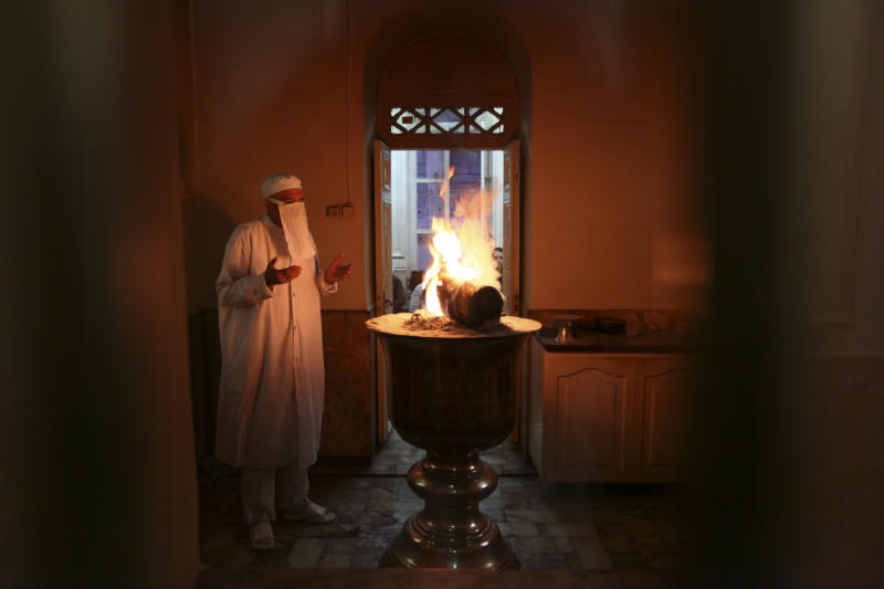FILE - An Iranian Zoroastrian priest performs a ritual at a fire temple in Tehran, Iran on Monday, Sept. 12, 2011. In Zoroastrian creation mythology, the god of light, Ahura Mazda, created an egg-shaped universe of good - first spiritual, and then, after 3,000 years, physical. Then he made the perfect man, Gayomard, and the first bull. Meanwhile, another god - Angra Mainyu - created an opposite universe of evil, which contained everything but humans, which he could not make. So he invaded the good universe and killed Gayomard and the bull. But their seeds grew into the world's beneficial living things, and into a plant whose leaves formed Mashya and Mashyana, man and woman. Angra Mainyu's incursion introduced the bad things in the world, including the dark of night. Fire plays a central role in worship as a symbol of truth and the spirit of God. Prayer is often performed in front of a fire, and consecrated fires are kept perpetually burning in major temples. (AP Photo)