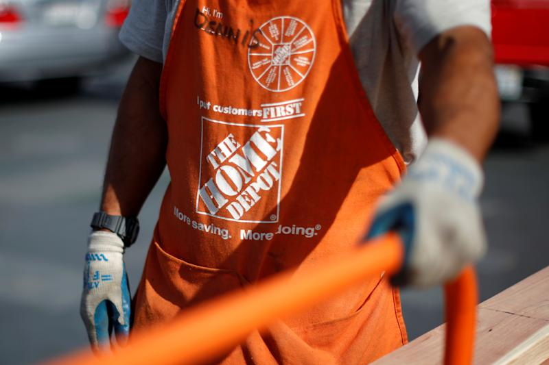 A Home Depot employee is seen outside a store in Los Angeles, California March 17, 2015. REUTERS/Lucy Nicholson/File Photo