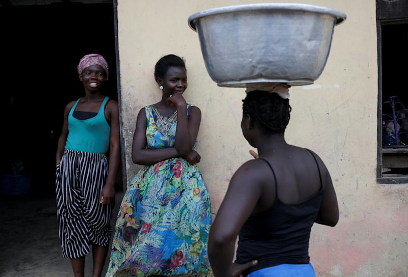 Enestina Kojo, Hagar Boadu Washington and Babara Oteng chat in Prestea, a mining town in southwest Ghana. (Photo: Siphiwe Sibeko/Reuters)