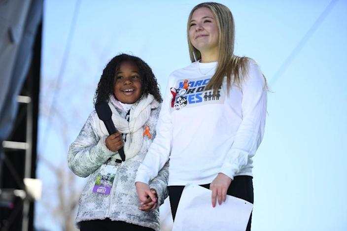 Martin Luther King Jr's granddaughter Yolanda Renee King (L) speaks next to student Jaclyn Corin during the March for Our Lives rally in Washington on March 24, 2018 (AFP Photo/JIM WATSON)