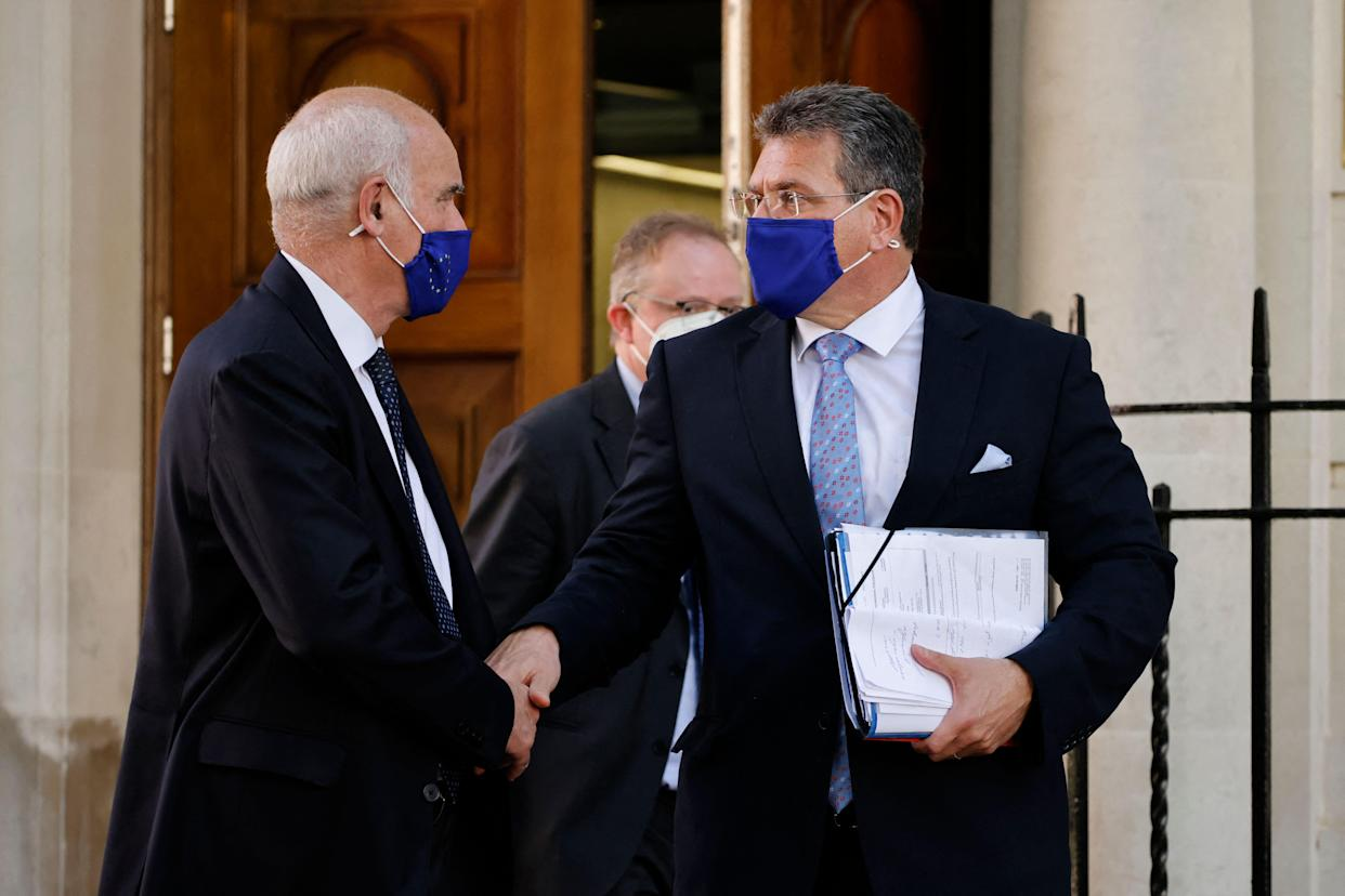 European Commission vice president Maros Sefcovic (R) leaves Europe House, the headquarters of the EU delegation in the UK in London on June 9, 2021. - The European Union on Wednesday threatened Britain with retaliatory action if it refuses to implement post-Brexit trading arrangements in Northern Ireland, after talks to solve the simmering row broke up without agreement. (Photo by Tolga Akmen / AFP) (Photo by TOLGA AKMEN/AFP via Getty Images)