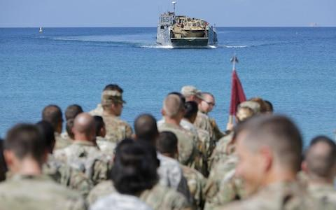 Soldiers from the 602nd Area Support Medical Company wait on a beach for a Navy landing craft as their unit evacuates in advance of Hurricane Maria - Credit: JONATHAN DRAKE/Reuters