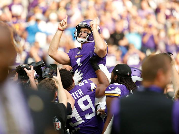 Greg Joseph celebrates with teammates after a game-winning field goal against the Detroit Lions.