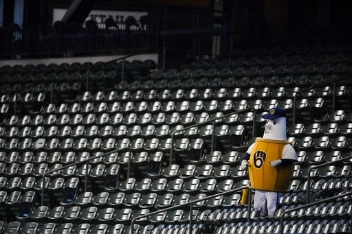 A Milwaukee Brewers mascot cheers in the empty stands during the fourth inning of a baseball game against the Chicago White Sox Tuesday, Aug. 4, 2020, in Milwaukee. (AP Photo/Morry Gash)