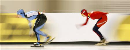 Germany's Claudia Pechstein skates to a second place finish against Czech Republic's Martina Sablikova in Salt Lake City