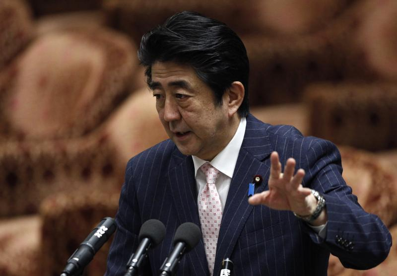 Japan's PM Abe speaks during a lower house budget committee session at the parliament in Tokyo