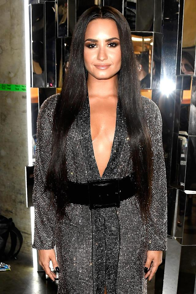 """<p>Do you believe Lovato was inspired by Cher and other '70s-era artists when she performed in a sparkling dress and Cher-like tresses at the 2017 Grammys? You should, because she sang """"Stayin' Alive"""" in tribute to the Bee Gees. It doesn't get much more '70s than that! (Photo: Frazer Harrison/Getty Images for NARAS) </p>"""