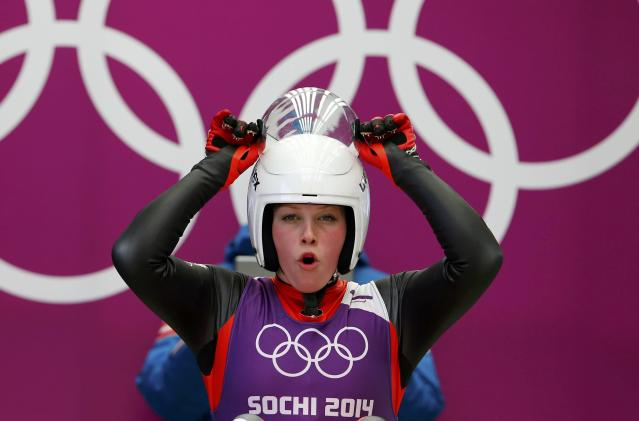 Austria's Miriam Kastlunger adjusts her helmet at the women's singles luge training session at the Sochi 2014 Winter Olympic Games at the Sanki Sliding Center February 8, 2014. REUTERS/Arnd Wiegmann (RUSSIA - Tags: SPORT LUGE OLYMPICS)