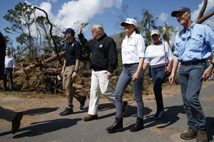 President Donald Trump and first lady Melania Trump tour a neighborhood affected by Hurricane Michael, Monday, Oct. 15, 2018, in Lynn Haven, Fla. From left are FEMA director Brock Long, Trump, the first lady, Margo Anderson, Mayor of Lynn Haven, Fla., and Florida Gov. Rick Scott, right. (AP Photo/Evan Vucci)