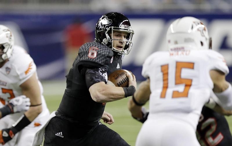 Northern Illinois quarterback Jordan Lynch scrambles through the Bowling Green defense during the first quarter of an NCAA college football game at the Mid-American Conference championship in Detroit, Friday, Dec. 6, 2013. (AP Photo/Carlos Osorio)