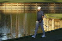Dustin Johnson walks off the green on the 17th hole during the first round of the The Players Championship golf tournament Thursday, March 11, 2021, in Ponte Vedra Beach, Fla. (AP Photo/John Raoux)