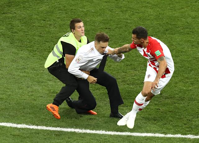 A pitch invader is stopped by Dejan Lovren of Croatia during the 2018 FIFA World Cup Final between France and Croatia at Luzhniki Stadium on July 15, 2018 in Moscow, Russia. (Getty Images)