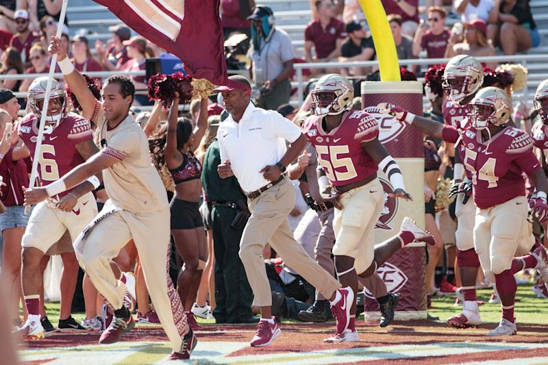 TALLAHASSEE, FL - SEPTEMBER 07: Florida State Seminoles head coach Willie Taggart runs onto the field with his team before the game between Florida State Seminoles and the Louisiana-Monroe Warhawks on September 7, 2019, at Doak Campbell Stadium in Tallahassee, Florida. (Photo by Logan Stanford/Icon Sportswire via Getty Images)