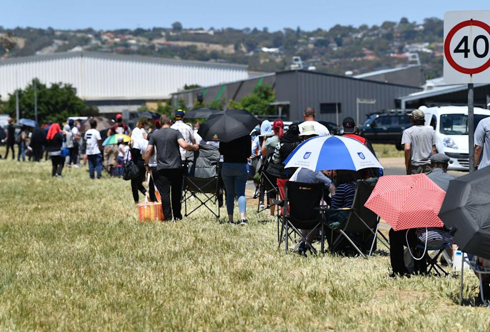 People are seen queuing up at the Parafield Gardens COVID testing centre in Adelaide, Australia.
