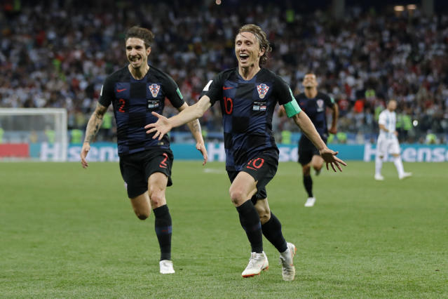 Croatia's Luka Modric, right, celebrates with teammates after scoring his side's second goal during the group D match between Argentina and Croatia at the 2018 soccer World Cup in Nizhny Novgorod Stadium in Nizhny Novgorod, Russia, Thursday, June 21, 2018. Modric scored once in Croatia's 3-0 victory. (AP Photo/Ricardo Mazalan)