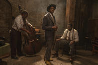 "This image released by Netflix shows Michael Potts, from left, Chadwick Boseman and Colman Domingo in ""Ma Rainey's Black Bottom."" Boseman won the award for best actor in a motion picture drama at the Golden Globes on Sunday, Feb. 28, 2021. (David Lee/Netflix via AP)"