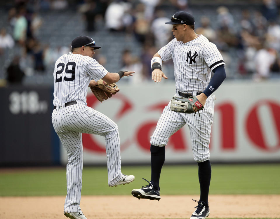 New York Yankees' Gio Urshela (29) and Aaron Judge celebrate after defeating the Baltimore Orioles during a baseball game, Wednesday, Aug. 14, 2019, in New York. (AP Photo/Mary Altaffer)