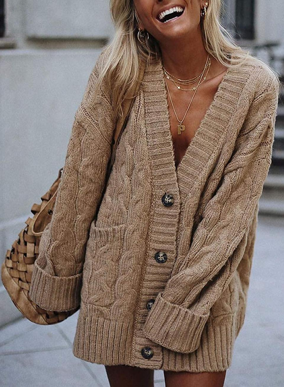 """<p>This classic <a href=""""https://www.popsugar.com/buy/Sidefeel-Cardigan-Sweater-522520?p_name=Sidefeel%20Cardigan%20Sweater&retailer=amazon.com&pid=522520&price=34&evar1=fab%3Aus&evar9=46936276&evar98=https%3A%2F%2Fwww.popsugar.com%2Ffashion%2Fphoto-gallery%2F46936276%2Fimage%2F46936780%2FSidefeel-Cardigan-Sweater&list1=shopping%2Camazon%2Cwinter%20fashion&prop13=api&pdata=1"""" rel=""""nofollow noopener"""" class=""""link rapid-noclick-resp"""" target=""""_blank"""" data-ylk=""""slk:Sidefeel Cardigan Sweater"""">Sidefeel Cardigan Sweater </a> ($34) comes in tons of colors.</p>"""