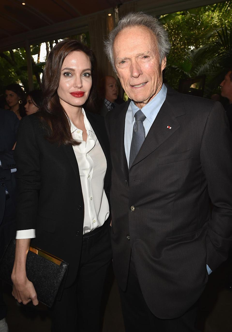 "Angelina Jolie was honored for directorial efforts for ""Unbroken."" She wore a black blazer, with black skinny pants, and heels and paired the look with a loose waves and a striking red lip. Clint Eastwood, who also has a film out, was also in attendance."