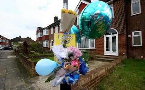 Floral and birthday tributes at the scene on South Park Crescent in Hither Green, London - Credit: Gareth Fuller/PA