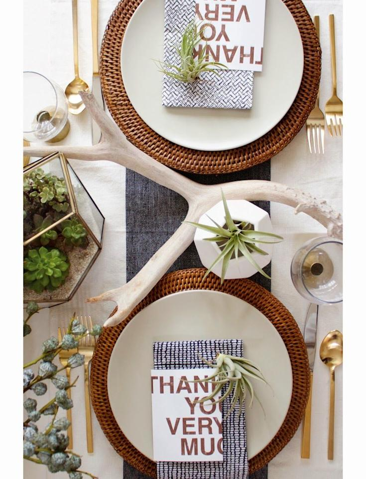 """<p>Bold typography isn't the only modern element in this tasteful scene. A selection of small air plants and <a href=""""https://www.amazon.com/Berglander-Flatware-Stainless-Titanium-Silverware/dp/B07536QR2Y"""" target=""""_blank"""">brass silverware</a> add to the effect. </p><p><strong style="""""""">Get the tutorial at <a href=""""http://www.craftandcouture.com/2013/11/a-modern-organic-thanksgiving-table.html?m=1"""" target=""""_blank"""">Craft and Couture</a>.</strong><br></p><p><strong><a class=""""body-btn-link"""" href=""""https://www.amazon.com/Air-Plant-Shops-Tillandsia-Ionantha/dp/B0080YLBTM?tag=syn-yahoo-20&ascsubtag=%5Bartid%7C10050.g.634%5Bsrc%7Cyahoo-us"""" target=""""_blank"""">SHOP AIR PLANTS</a><br></strong></p>"""