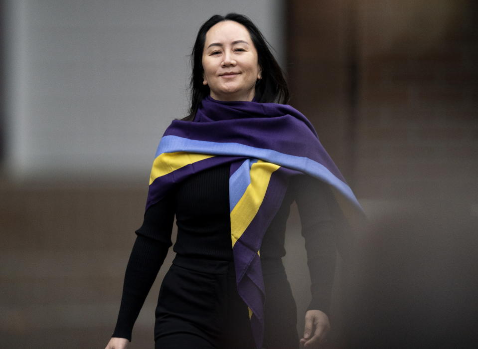 Chief Financial Officer of Huawei, Meng Wanzhou leaves her home in Vancouver, British Columbia, Wednesday, Oct. 28, 2020. Wanzhou is heading to the British Columbia Supreme Court in an evidentiary hearing on her extradition case. (Jonathan Hayward/The Canadian Press via AP)