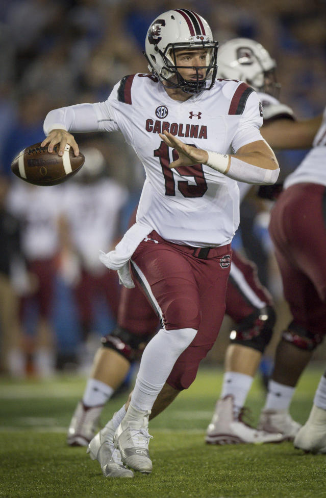 South Carolina quarterback Jake Bentley (19) scrambles with the ball during the first half of an NCAA college football game against Kentucky in Lexington, Ky., Saturday, Sept. 29, 2018. (AP Photo/Bryan Woolston)