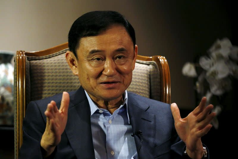 FILE PHOTO: Former Thai Prime Minister Thaksin Shinawatra speaks to Reuters during an interview in Singapore