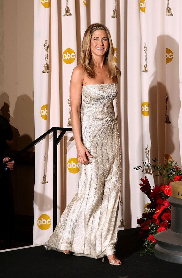 "Jennifer Aniston   Grade: B       The former ""Friend"" attempted to give her arch nemesis Angelina Jolie a run for her money in Fred Leighton jewels and a lovely column gown courtesy of Valentino."