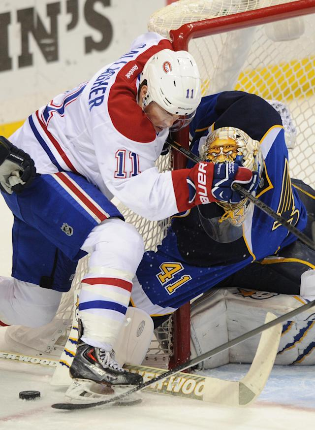 St. Louis Blues' goalie Jaroslav Halak (41), of Slovakia, blocks a shot by Montreal Canadiens' Brendan Gallagher (11) during the second period of an NHL hockey game on Thursday, Dec. 19, 2013, in St. Louis. (AP Photo/Bill Boyce)