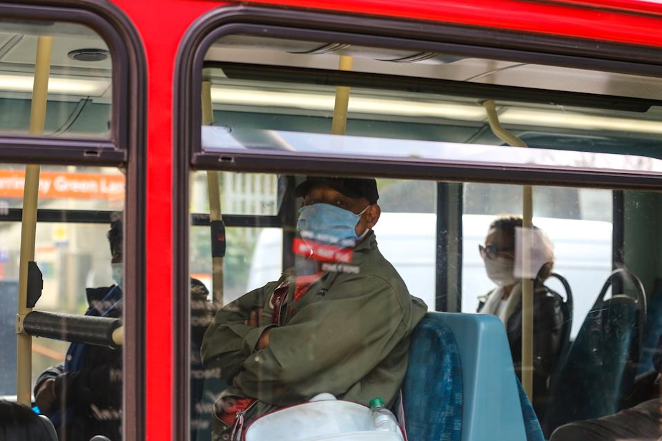 A passenger on a London bus wearing a protective mask as a preventive measure during COVID-19 outbreak. The Mayor of London has said that from Monday 20 April 2020 passengers travelling on London buses will not have to pay as a new measure to protect bus drivers from coronavirus. (Photo by Steve Taylor / SOPA Images/Sipa USA)