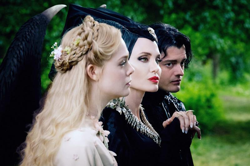MALEFICENT: MISTRESS OF EVIL, from left: Elle Fanning as Aurora, Angelina Jolie as Maleficent, Sam Riley as Diaval, 2019. ph: Jaap Buitendijk / Walt Disney Studios Motion Pictures / courtesy Everett Collection