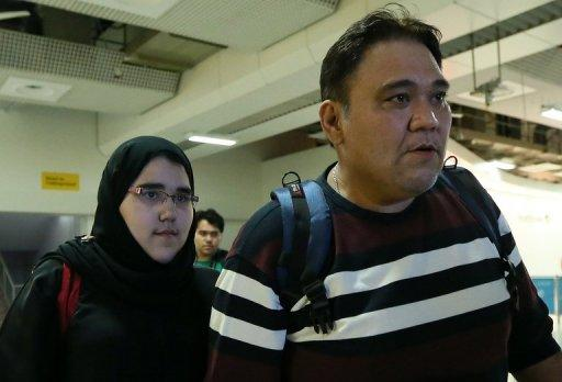 Female Saudi Judo athlete Wojdan Shaherkani arrives with her father at Heathrow airport in preparation for the London Olympics on Wednesday. Saudi Arabia have complained to the International Olympic Committee (IOC) after she was banned from wearing the hijab headscarf during competition