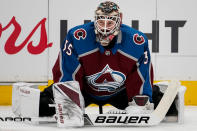 Colorado Avalanche goaltender Andrew Hammond stretches during warmups in Game 6 of an NHL hockey first-round playoff series against the Nashville Predators, Sunday, April 22, 2018, in Denver. (AP Photo/Jack Dempsey)