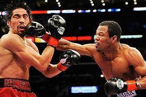 On Jan. 24, 2009, Antonio Margarito, left, tried to get into the ring before his bout against Shane Mosley with an illegal knuckle pad in his right hand wrap. Margarito paid the price or did he?