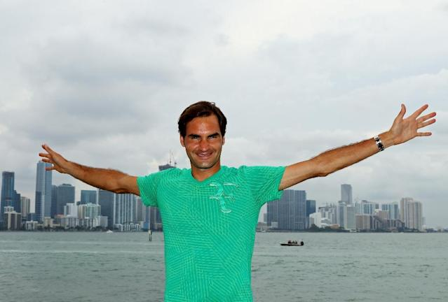 Roger Federer of Switzerland celebrates after defeating Rafael Nadal of Spain to win the Miami Open title, at Crandon Park Tennis Center in Key Biscayne, Florida, on April 2, 2017 (AFP Photo/Al Bello)