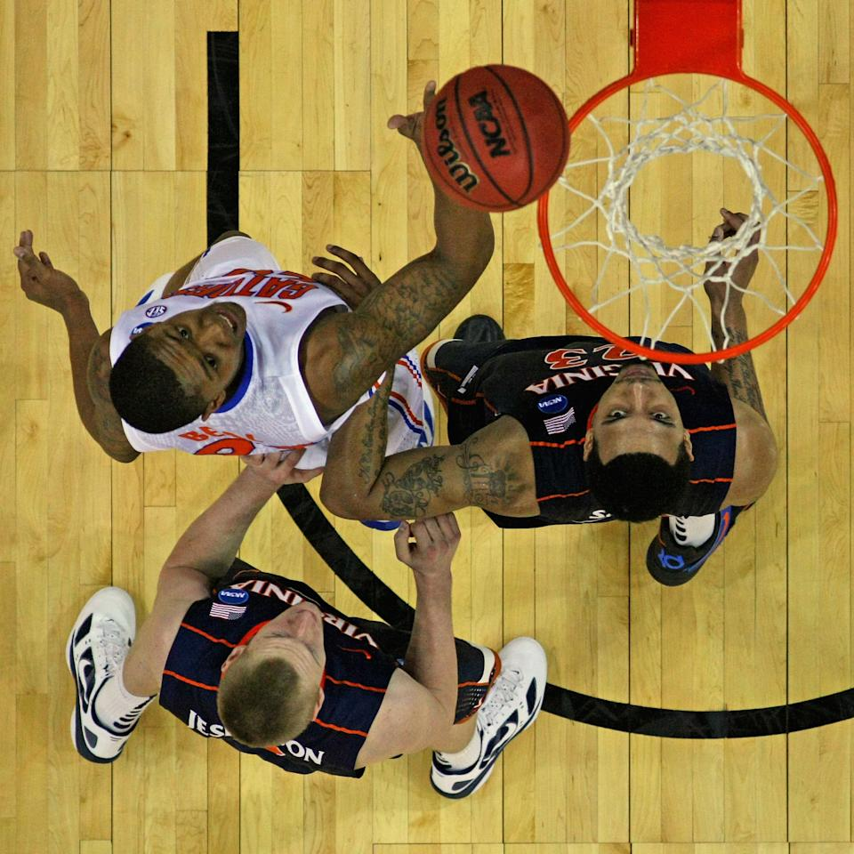 OMAHA, NE - MARCH 16:  Bradley Beal #23 of the Florida Gators lays up a shot against Paul Jeperson #2 and Mike Scott #23 of the Virginia Cavaliers in the second round of the NCAA Men's Basketball Tournament at CenturyLink Center on March 16, 2012 in Omaha, Nebraska. Florida defeated Virginia 71-45.  (Photo by Doug Pensinger/Getty Images)