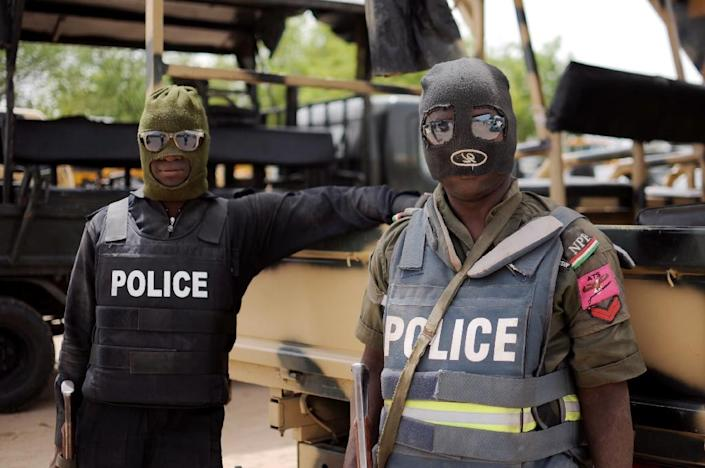 Nigerian police in Borno state pose prior to a patrol in Maiduguri on June 5, 2013 (AFP Photo/Quentin Leboucher)