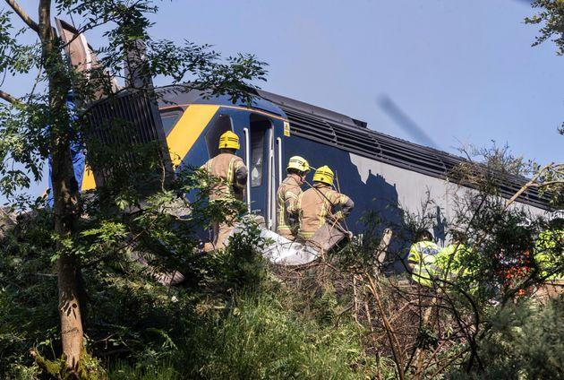 Emergency services attend the scene of a derailed train in Stonehaven,
