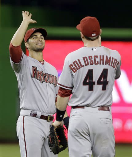 Arizona Diamondbacks first baseman Paul Goldschmidt (44) and third baseman Eric Chavez, rear, celebrate after the Diamondbacks defeated the Miami Marlins 1-0 in a baseball game, Saturday, May 18, 2013 in Miami. (AP Photo/Wilfredo Lee)