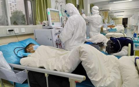 Central Hospital of Wuhan show medical staff attending to patients, in Wuhan, China