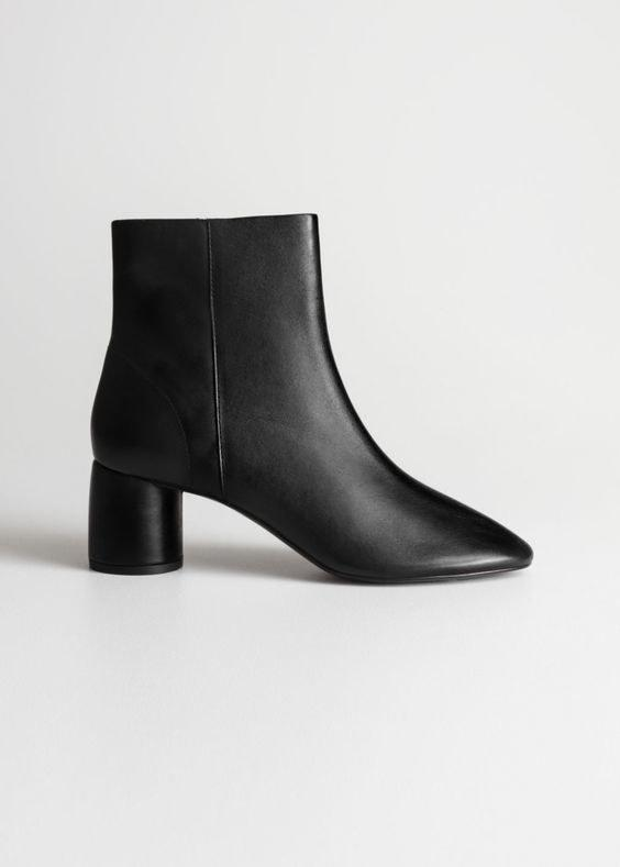 """$179, & Other Stories. <a href=""""https://www.stories.com/en_usd/shoes/boots/ankleboots/product.cylinder-heel-ankle-boots-black.0655187001.html"""">Get it now!</a>"""